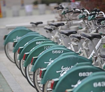 Changwon, South Korea - March 9, 2013: Nubija rental bicycles - shared by city residents - line the sidewalk in Changwon, South Korea.